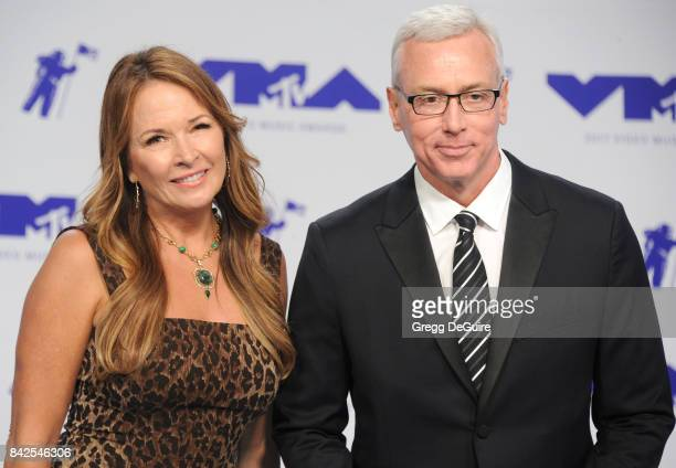 Dr Drew Pinsky and wife Susan Pinsky arrive at the 2017 MTV Video Music Awards at The Forum on August 27 2017 in Inglewood California