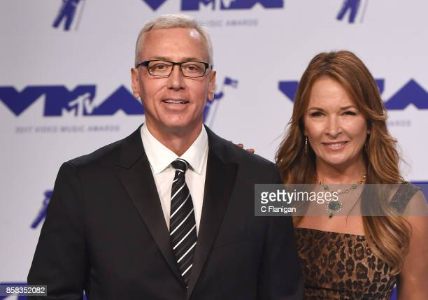 Dr Drew Pinsky and wife Susan Pinsky attend the 2017 MTV Video Music Awards at The Forum on August 27 2017 in Inglewood California