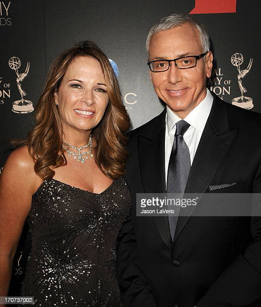 Dr Drew Pinsky and wife Susan Pinsky attend the 40th annual Daytime Emmy Awards at The Beverly Hilton Hotel on June 16 2013 in Beverly Hills...