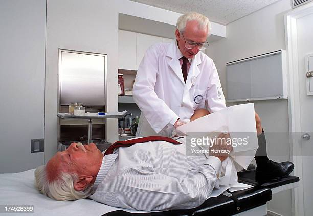 Dr E Douglas Whitehead conducts a prostate examination on a patient February 13 1991 at his office in New York City