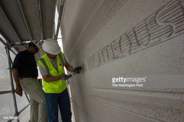Dr Ed Jackson chats with project foreman Yimo Lei as the words of a carved quote are chiseled away on the Martin Luther King Jr Memorial Statue in...