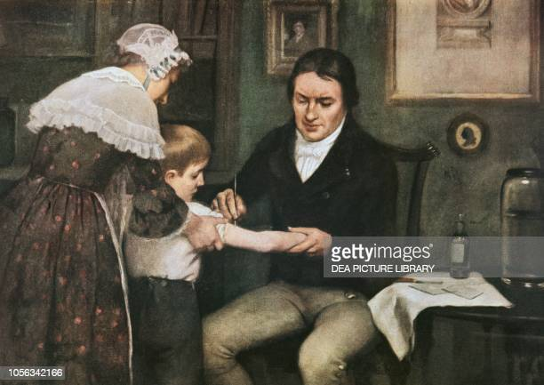 Dr Edward Jenner performing his first vaccination against smallpox on James Phipps, a boy of eight, May 14 oil on canvas by Ernest Board , 1920-1930,...