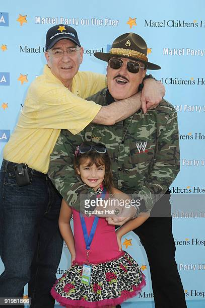 Dr Edward McCabe Sergeant Slaughter and Alexis Burnett arrive at the Mattel Party On The Pier on October 18 2009 in Santa Monica California