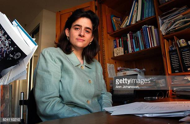 Dr Elizabeth Bancroft a medical epidemiologist with the Los Angeles County Health Department pose for a portrait in her home office in Santa Monica