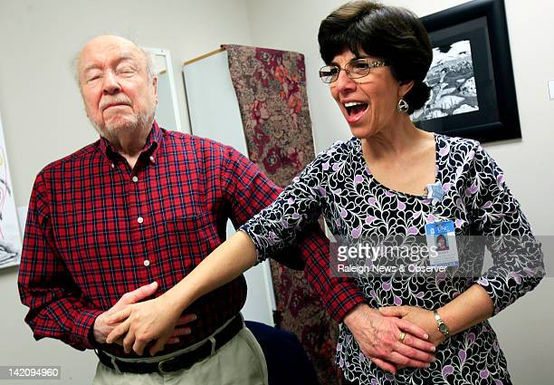 Dr Ellen Markus right speech language pathologist with UNC Voice Center teaches speaking techniques to Ray Carpenter of Chapel Hill during a vocal...