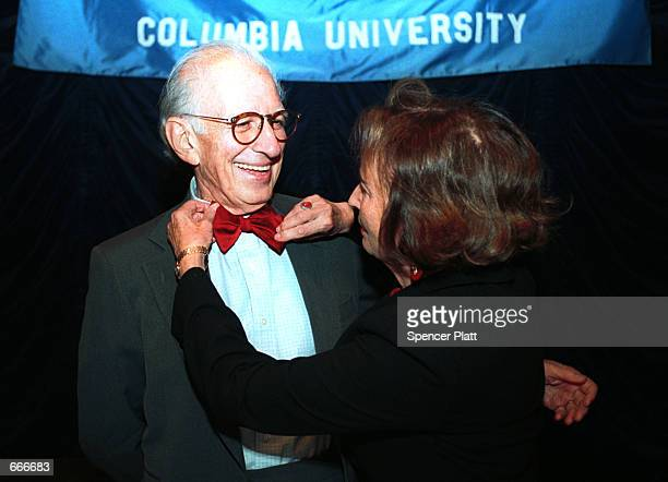 Dr Eric Kandel Columbia University Professor smiles as his wife Denise adjusts his red bowtie during a press conference October 9 2000 in New York...