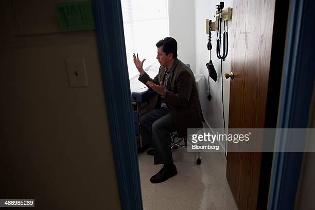 Dr Esteban Lovato speaks with a patient at the La Loma Medical Center in Oakland California US on Friday Jan 31 2014 Enrollment has lagged among...
