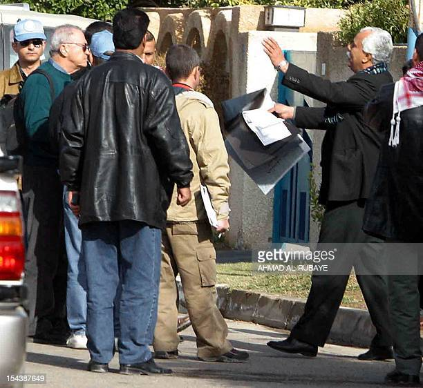 Dr Faleh Hasan Hamza head of the alRazi Iraqi military complex factory gestures to UNSCOM inspectors as he holds Xrays belonging to his wife in the...
