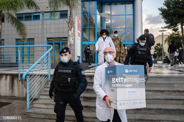 Dr. Francesco Gervasi receives the vaccines from the representative of the Italian Army. Civico Hospital in Palermo Kicks-off Sicilys Covid-19...