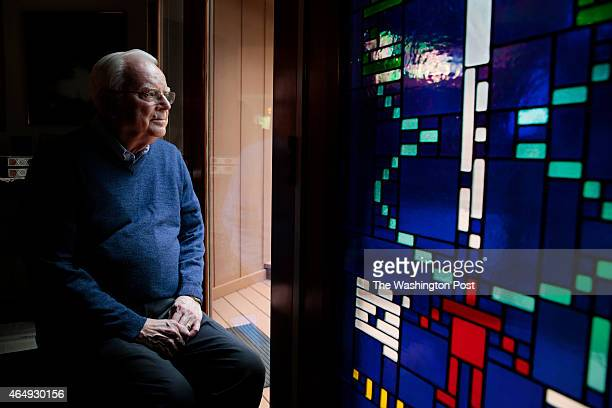 Dr Frank Drake the founder of SETI poses for a portrait next to a stained glass window with the Arecibo Message at his home in Aptos California...