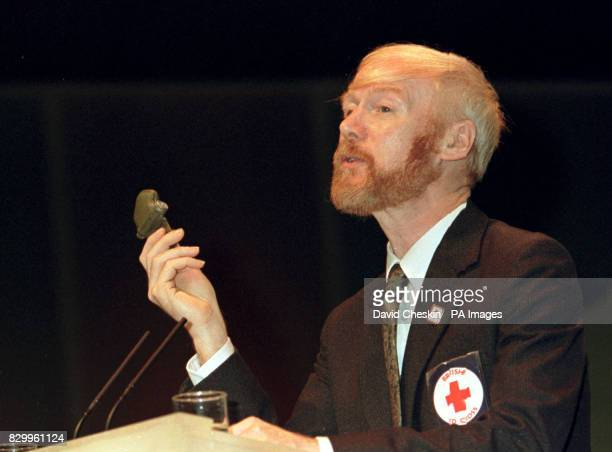 Dr Frank Ryding of the Red Cross holding a piece of landmine addresses the 'Leadership in the World' debate at the labour Party conference in...
