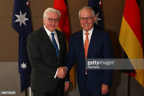 Dr FrankWalter Steinmeier President of Germany shakes hands with Malcolm Turnbull Prime Minister of Australia prior to their bilateral meeting at the...