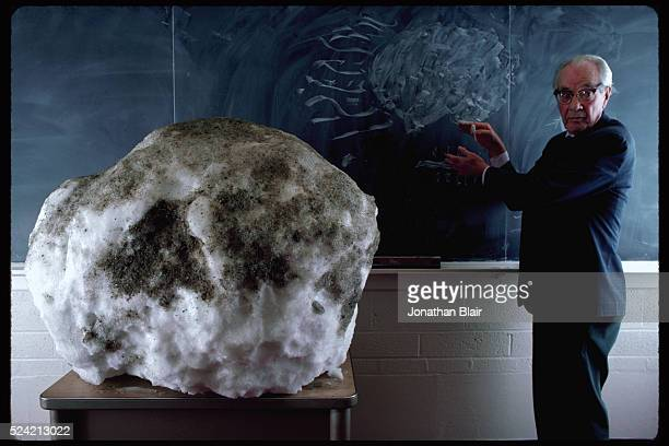 Dr Fred Whipple uses a 500 pound snowball covered with dirt in his Harvard classroom to demonstrate the anatomy of a comet's nucleus | Location...
