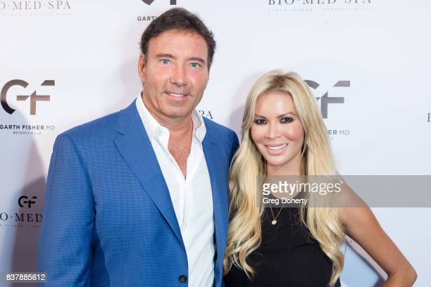 Dr Garth Fisher and Chanel Lee attend the Official Launch Party Of Dr Garth Fisher's BioMed Spa at Garth Fisher MD on August 22 2017 in Beverly Hills...