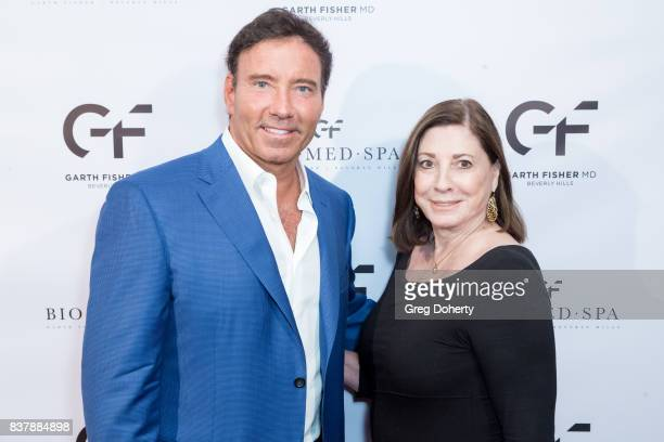 Dr Garth Fisher and iHeart Radio Host Judith Mancini attend the Official Launch Party Of Dr Garth Fisher's BioMed Spa at Garth Fisher MD on August 22...