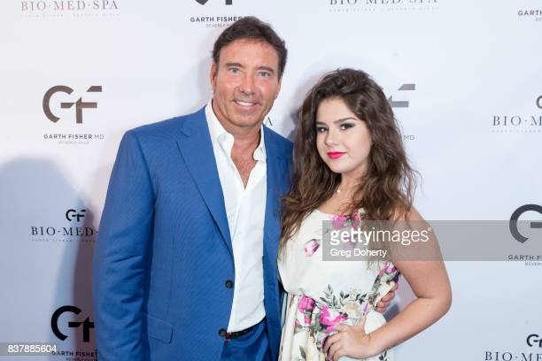 Dr Garth Fisher and Nexar Recording Artist Sara Serena attends the Official Launch Party Of Dr Garth Fisher's BioMed Spa at Garth Fisher MD on August...