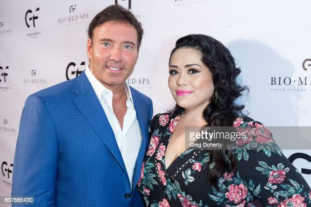Dr Garth Fisher MD and TV Host and Radio Personality Ana Vergara attend the Official Launch Party Of Dr Garth Fisher's BioMed Spa at Garth Fisher MD...