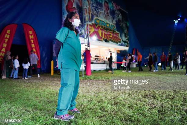 Dr Geetha Chandrasekaran waits for patients at a new 'Pop Up' vaccination centre in the Big Top of Circus Extreme in Shibden Park on July 31, 2021 in...
