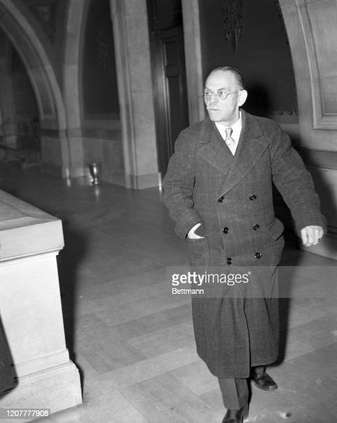 Dr. George Harley of Newark is shown entering court to stand trial for conducting a dues-paying abortion club. Deputy Police Commissioner Philip...