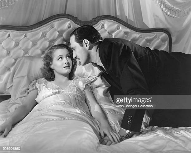 Dr George Sebastian leans into kiss Linda Booth in the 1941 motion picture The Mad Doctor