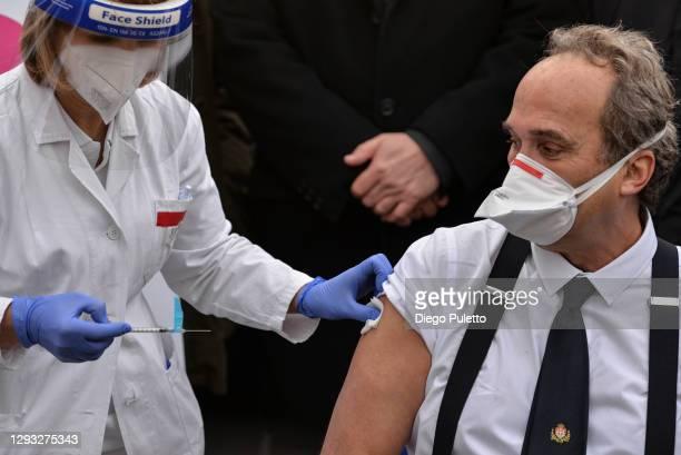 Dr. Giovanni Di Perri receives the Pfizer-BioNTech COVID-19 vaccine outside the Amedeo di Savoia ward in Turin on December 27, 2020 in Turin, Italy....