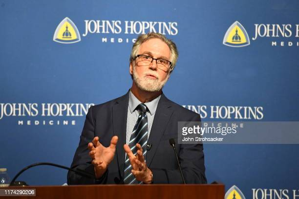 Dr Gregg L Semenza MD PhD addresses the media and a large crowd from Johns Hopkins Hospital at a press conference after learning he won the Nobel...