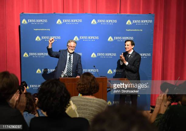 Dr Gregg L Semenza MD PhD and Johns Hopkins president Ronald Joel Daniels address the media and large crowd from Johns Hopkins Hospital at a press...