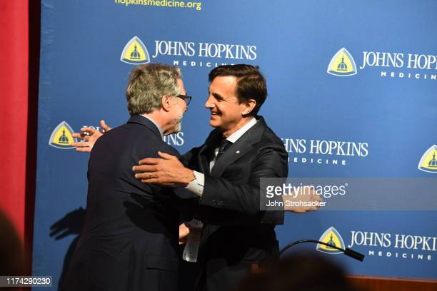 Dr Gregg L Semenza MD PhD is congratulated by Johns Hopkins president Ronald Joel Daniels at a press conference after learning he won the Nobel Prize...