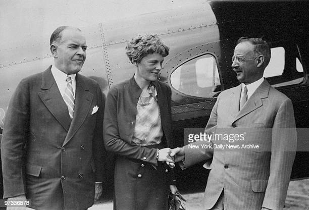Dr Grosvenor President of the National Geographic Society shakes hands with Amelia Earhart at Hoover Field