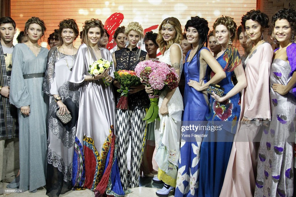 H.E. Dr Gulnara Karimova, Chairwoman of the Board of Trustees Fund Forum surrounded by models, acknowledges applause following the Guli live show during Style.Uz Art Week 2013 at Ichan-Qala Hotel on October 26, 2013 in Tashkent, Uzbekistan.