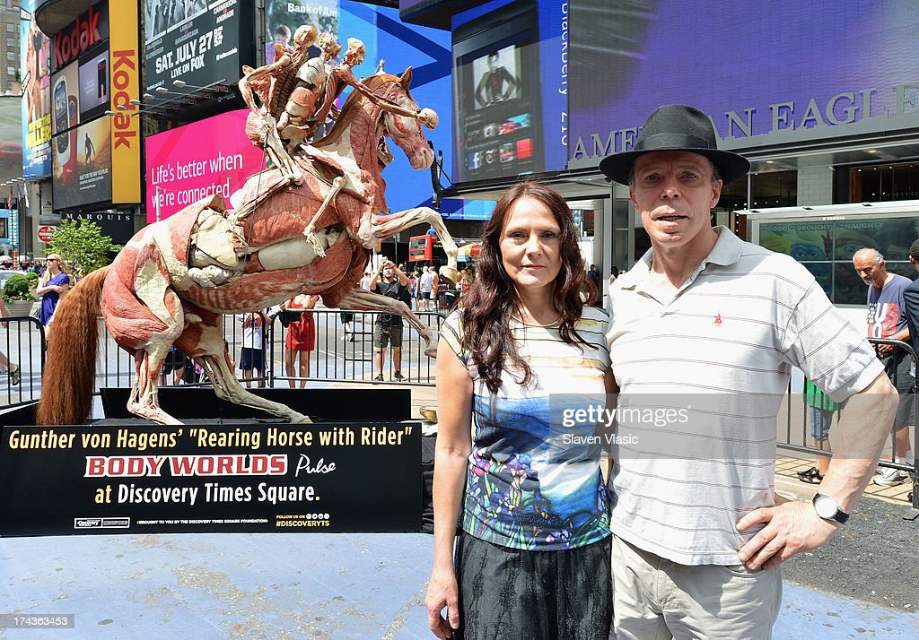 Dr. Gunther von Hagens (R) and wife Dr. Angelina Whalley pose front of 'Rearing Horse With Rider', one of Dr. von Hagens most recognized anatomical specimens during the public unveiling at Times Square on July 24, 2013 in New York City. This work will then be included as part of the 'Body Worlds: Pulse' exibit from July 25th onward at Discovery Times Square. 'Body Worlds' is an international anatomical art and science exibition that displays preserved human bodies through a process called Plastination, which reveals inner anatomical structures.