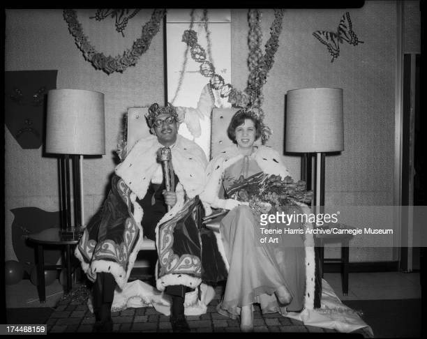 Dr H Raymond Primas and Barbara Hale wearing king and queen costumes for D I Club's Mardi Gras Ball Hilton Hotel Pittsburgh Pennsylvania March 1965