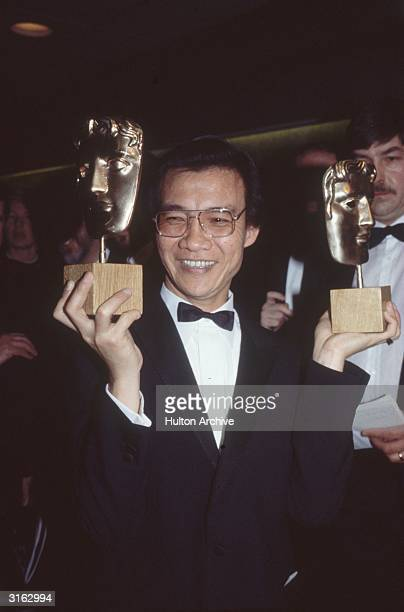 Dr Haing S Ngor the Cambodian star of 'The Killing Fields' at a BAFTA ceremony at the Grosvenor House Hotel London holding his awards for Best Actor...