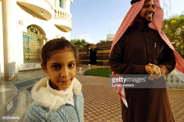 Dr Halil Al Halili and his daughter at their house in Riyadh Saudi Arabia December 2003