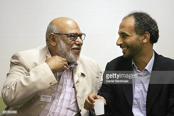 Dr Hamal Kabawi speaks to Prof Dr Tariq Ramadan during The Middle Path Conference at the Islamic Cultural Centre on July 24 2005 in London England...