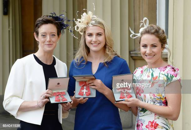 Dr Hannah Macleod Shona McCallin and Lily Owsley hold their MBE Medals after receiving them from the Prince of Wales during an investiture ceremony...