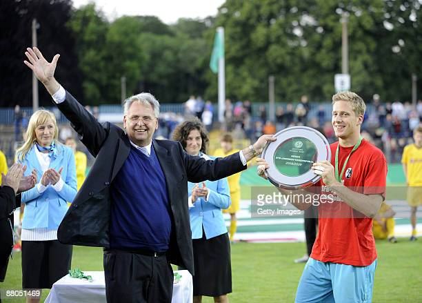 Dr HansDieter Drewitz hands over the trophy to Oliver Baumann of Freiburg of Dortmund after the DFB Juniors Cup final match between SC Freiburg and...