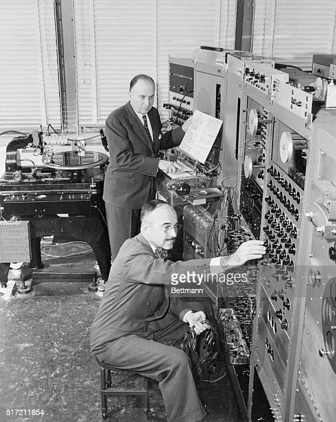 Dr Harry F Olson at the keyboard and Mr Herbert Belar at the control panel operate RCA's new Electronic Music Synthesizer developed at the David...