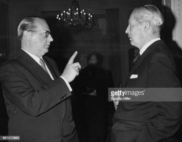 Dr Heinrich von Brentano the German Foreign Minister chats with British Prime Minister Harold Macmillan at the German Embassy in Belgrave Square...
