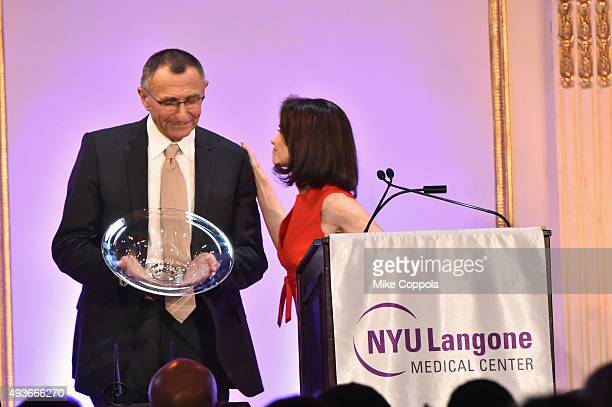 Dr Hersch Leon Pachter accepts his NYU Langone Medical Center's Perlmutter Cancer Center Honoree Award from Lori Fink at NYU Langone Medical Center's...