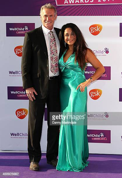Dr Hilary Jones and friend attend the WellChild Awards at London Hilton on September 22 2014 in London England