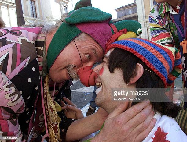 Dr Hunter Patch Adams founder of the Gesundheit Institute a medical center in West Virginia jokes with another clowndoctor during a performance at...