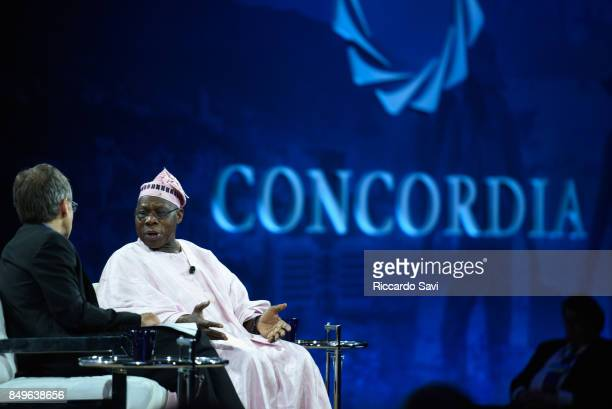 Dr Ian Bremmer Founder President of the Eurasia Group and HE Olusegun Obasanjo former President of Federal Republic of Nigeria speak at The 2017...