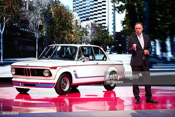 Dr. Ian Robertson, Member of the Board of Management of BMW AG, stands with the BMW 2002 Turbo during the 2016 North American International Auto Show...
