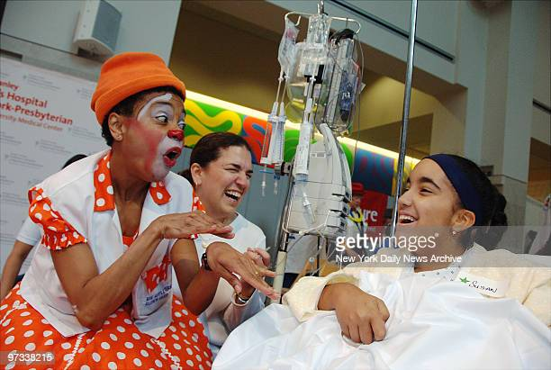 Dr Ima Confused entertains Susan Ayala and her mother Alex as the Big Apple Circus Clown Care program celebrates its 20th anniversary with a visit to...