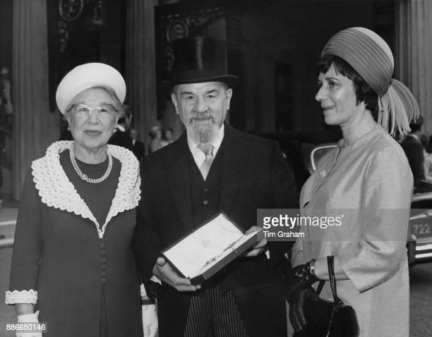 Dr Israel Brodie the Chief Rabbi of Great Britain and the Commonwealth with his wife and daughter after receiving a knighthood at Buckingham Palace...