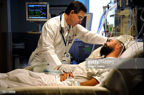Dr Ivor Douglas visits with Thomas McCarty in the Medical Intensive Care Unit at Denver Health in Denver CO Suffering from hospital associated...
