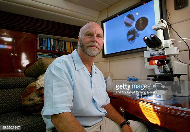 Dr J Craig Venter at his mircoscope on board his research vessel The Sorcerer II under the Sydney Harbour Bridge as a stopover on a 2 year long...