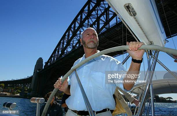 Dr J Craig Venter steers his research vessel The Sorcerer II under the Sydney Harbour Bridge as a stopover on a 2 year long expedition to collect...