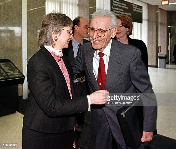 Dr Jack Kevorkian gets a hug from Melody Youk widow of the late Thomas Youk upon entering Oakland County Circuit Court 25 March 1999 in Pontiac...